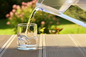Pouring water into a glass - benefits of soft water