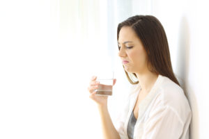 Rotten Egg Smell - Women with Disgusted Face